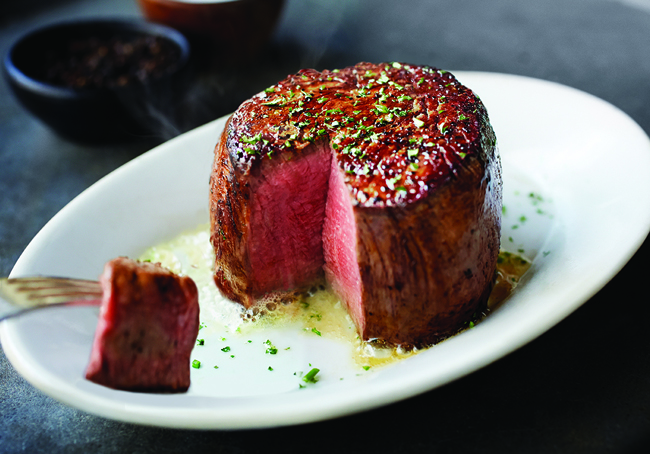 A slice of steak from Ruth's Chris Steakhouse, one of the top 5 steakhouses in Calgary