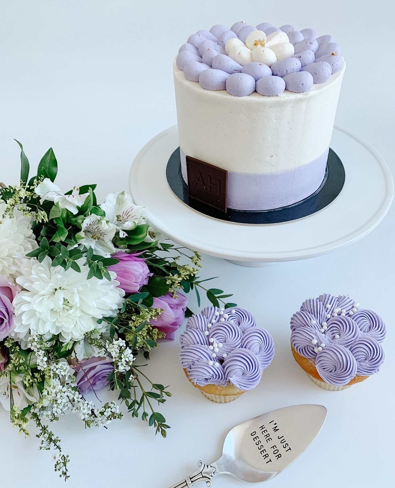 Purple Mother's Day cake from Arin Heibert subscription