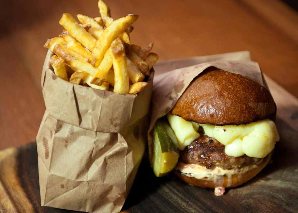 Burger and fries in paper bags, courtesy of Alley Burger